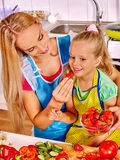 Mother feed child at kitchen Royalty Free Stock Photos