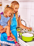 Mother  feed child at kitchen Stock Images