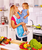 Mother  feed child at kitchen. Royalty Free Stock Photography