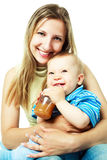 Mother feeding a baby Royalty Free Stock Photography