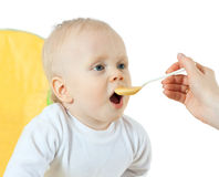 Mother feeding  baby Royalty Free Stock Photo