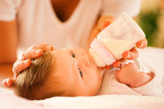 Mother is feeding the baby Royalty Free Stock Photo