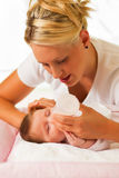 Mother is feeding the baby Royalty Free Stock Images