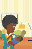 Mother feeding baby. Royalty Free Stock Photography