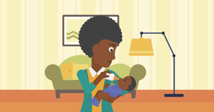 Mother feeding baby. Royalty Free Stock Images