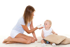 Mother feeding baby from bottle. Stock Photos