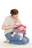 Mother feeding baby from bottle. Royalty Free Stock Photo