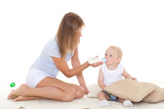 Mother feeding baby from bottle. Royalty Free Stock Photography