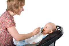 Mother feeding baby boy Royalty Free Stock Photos