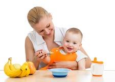Mother feeding baby boy royalty free stock photography
