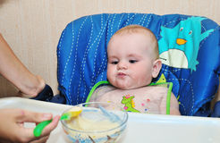 Mother feeding baby cereal Stock Image