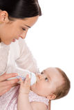 Mother feeding baby daughter royalty free stock photography