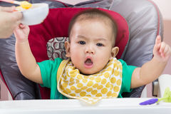 Mother feeding baby food Royalty Free Stock Image