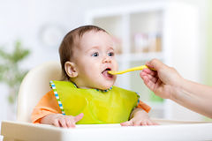 Mother feeding baby girl Royalty Free Stock Photo