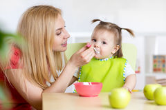 Mother Feeding Baby Stock Photos
