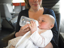 Mother Feeding Baby on Train Royalty Free Stock Images