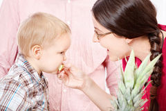 Mother feeding child. With apple Stock Photography