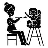 Mother feeding child icon, vector illustration, black sign on isolated background Stock Image