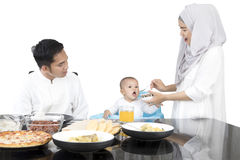 Mother feeding daughter with spoon Stock Photos