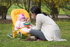 Mother feeding daughter royalty free stock images