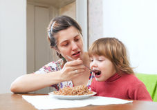 Mother feeding her 2 years child Stock Images