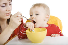 Mother feeding her baby Stock Photos