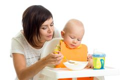 Mother feeding her baby boy Royalty Free Stock Image