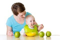Mother feeding her baby boy Royalty Free Stock Photos