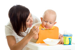 Mother feeding her baby boy Royalty Free Stock Photos