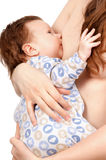 Mother feeding her baby with breast Royalty Free Stock Photography