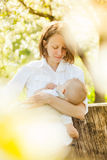 Mother feeding her baby with breast Stock Images