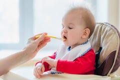 Mother feeding her baby breast porridge day Stock Image
