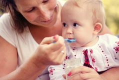 Mother feeding her baby Royalty Free Stock Photo