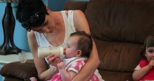 Mother feeding her baby girl