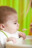 Mother feeding her baby son Royalty Free Stock Photography