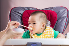 Mother feeding her child Royalty Free Stock Photography
