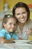 Mother feeding her daughter Royalty Free Stock Photos