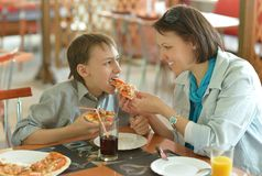 Mother feeding her son Royalty Free Stock Images