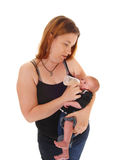 Mother feeding her three weeks old baby. Royalty Free Stock Images