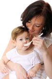 Mother feeding hungry baby royalty free stock photography