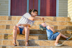 Mother Feeding Ice Cream to Son on Steps of Home Royalty Free Stock Photo