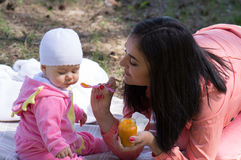 Mother feeding infant baby Stock Photography