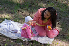 Mother feeding infant baby Stock Images