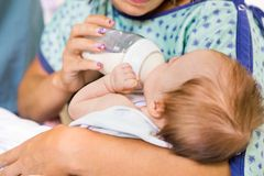 Mother Feeding Milk From Bottle To Newborn Baby Royalty Free Stock Photo