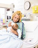Mother Feeding Milk To Baby Girl In Hospital Bed Royalty Free Stock Image