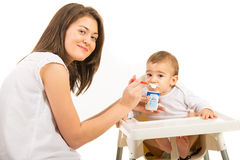 Mother feeding toddler boy Royalty Free Stock Photos