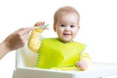 Mother feeding toddler girl Stock Photos