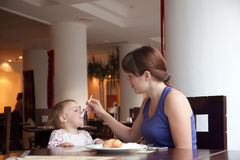 Mother feeding  year-old  daughter Royalty Free Stock Images
