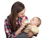 Mother feeds  baby boy Stock Images
