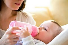 Mother feeds  baby Stock Image
